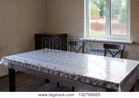 Dining Table And Two Chairs In Country House