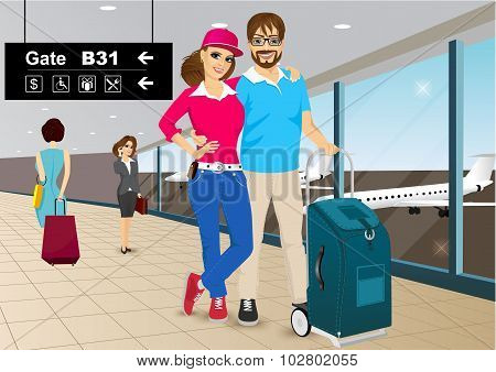 Happy Couple Standing In An Airport