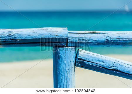 Blue Fence In Front Of The Sea