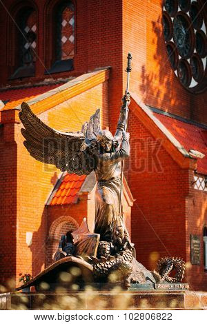Statue Of Archangel Michael near Red Catholic Church Of St. Simo