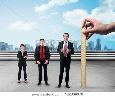 Hand Holding Wooden Ruler, Mesuring Employee Performance