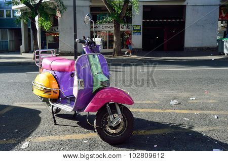 PARIS, FRANCE - AUGUST 10, 2015: Parked bright colors scooter. Paris, aka City of Love, is a popular travel destination and a major city in Europe
