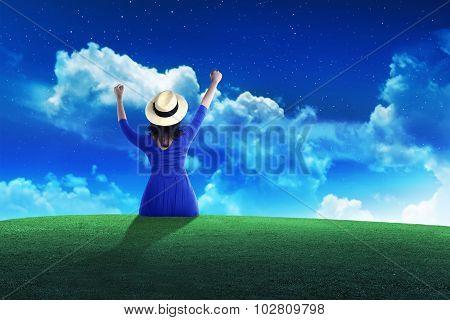 Tourist Woman Sit On The Grass