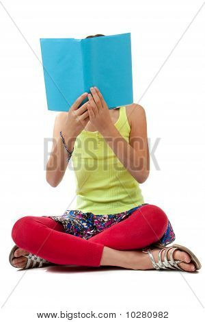 School Age Child Reading A Blue Book