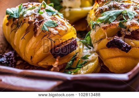 Potato.Roasts potatoes. Home cooking roasts potatoes. Baking pan full of baked potatoes stuffed with