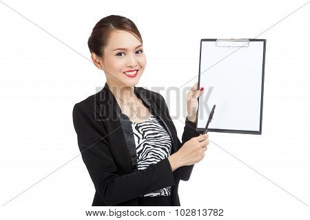 Happy Asian Business Woman Point To Clipboard With Pen