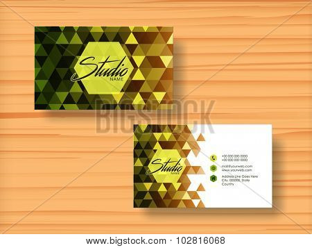 Abstract design decorated horizontal business card, visiting card or name card set on wooden background.