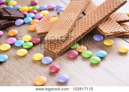 Chocolate Biscuits On Wooden Table With Color Sweets