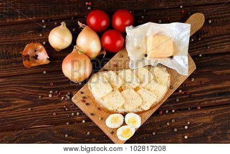 Top View On Table With Bread Cheese And Vegetable