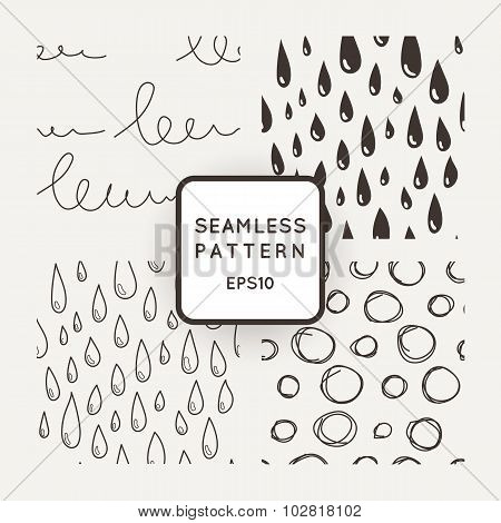 Set of vector seamless patterns with scribbles and raindrops