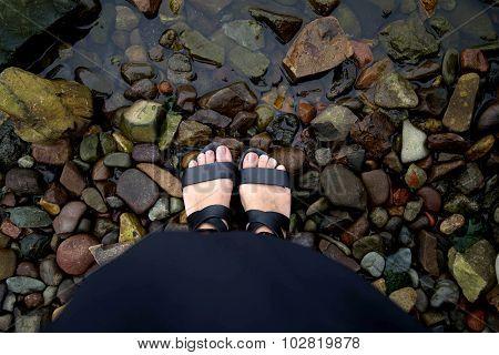 Feet on the stones