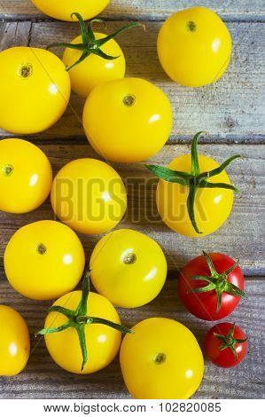 Organic Yellow Cherry Tomatoes  A Wooden Table