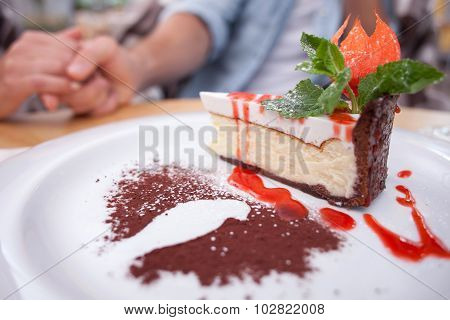 Cheerful young man and woman are eating in restaurant
