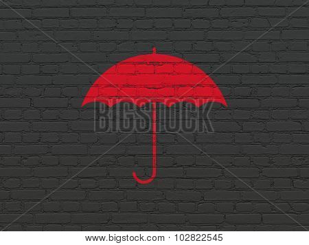 Security concept: Umbrella on wall background