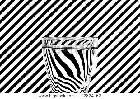 Abstract Refraction Of Black And White Diagonals In A Glass Of Water