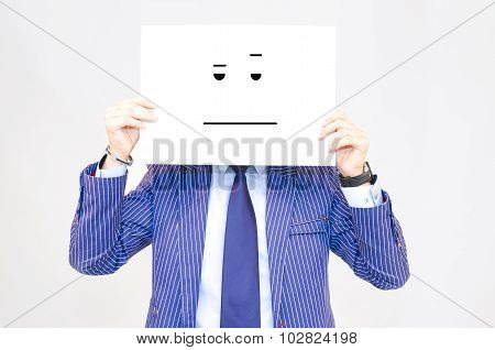 Business Man Hoding Cardwith Bored Face On Grey Background