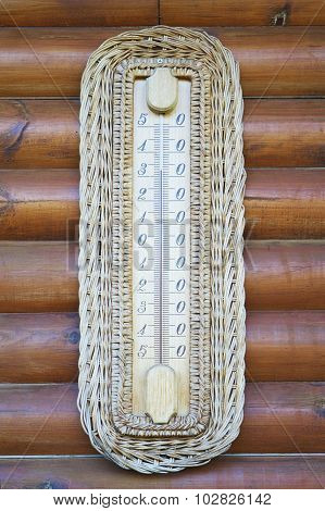Thermometer on wooden wall