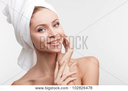 Attractive young girl is caring of her skin