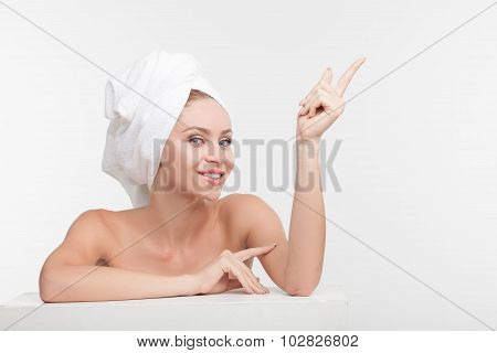 Cheerful young woman is caring of her body
