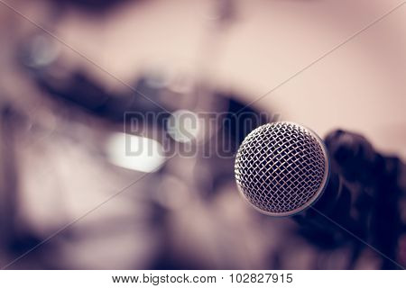 Selective Focus Microphone On Blur Drum Background.