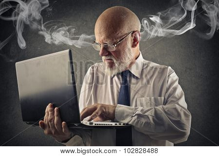 Angry man using a laptop