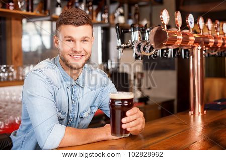 Handsome male bartender is working in bar