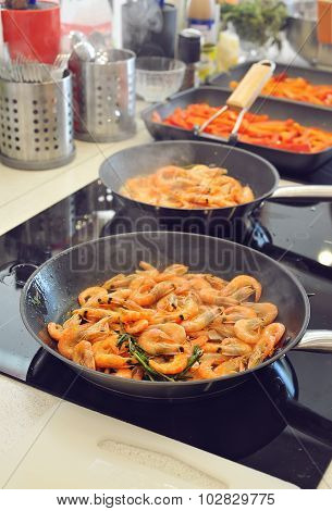 Stage of cooking pasta with shrimp, grilling shrimp. Selective focus
