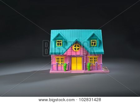 A colorful toy home on black background