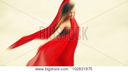 Blurred Woman With Red Fabric