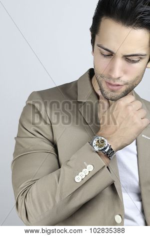Handsome man wearing a luxury watch