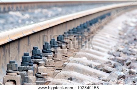 Closeup Of Rails And Sleepers Leaving Afar