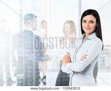 Side View Of The Smiling Brunette Woman With Crossed Hands. A Figures Of The Young Professionals In