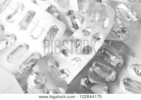 Pile Of Empty Medicine Blister Packs On White Surface.