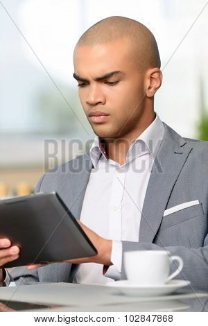Real businessman holding laptop