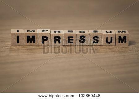 Impressum In Wooden Cubes