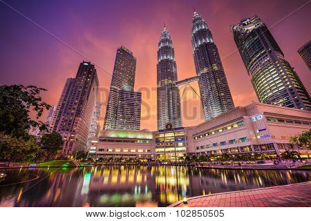KUALA LUMPUR - SEPTEMBER 21, 2015: The Petronas Towers viewed from KLCC Park at twilight.