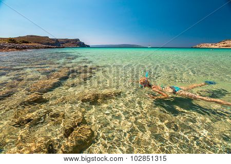 Woman snorkeling in tropical water