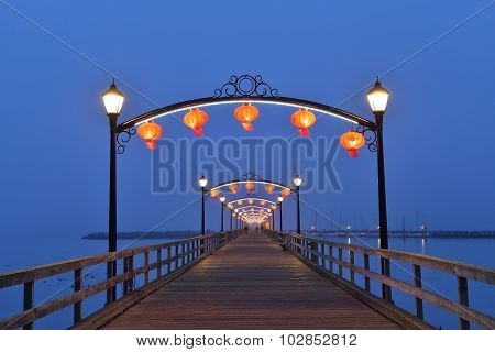 Red Lanterns On White Rock Pier For Chinese Moon Festival