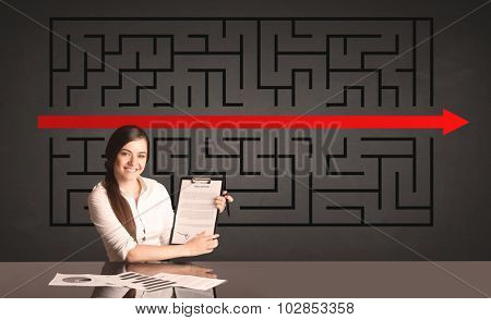 Successful businesswoman with a solved puzzle in background