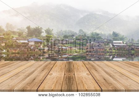 Wooden Board Empty Table blur lake in mountain - can be used for display or montage your products.