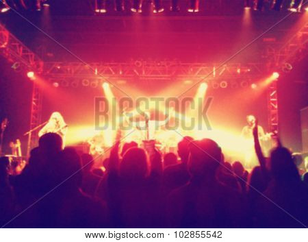 a crowd of people at a concert with a slight blur toned with a retro vintage instagram filter effect app or action