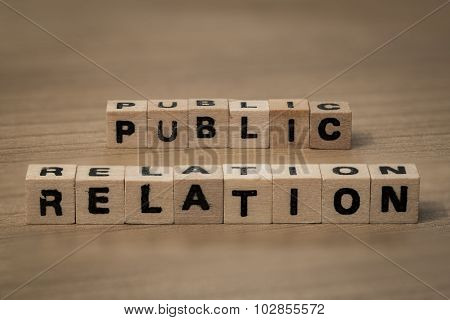 Public Relation In Wooden Cubes
