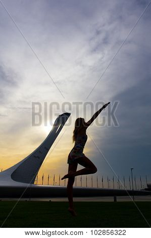 Young woman on olympic Sochi background