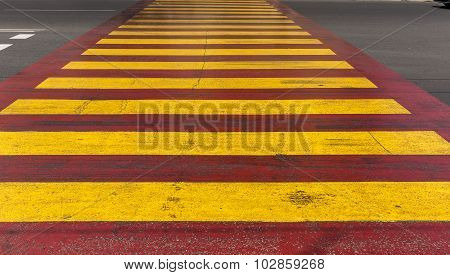 Red Yellow Crosswalk On The Road