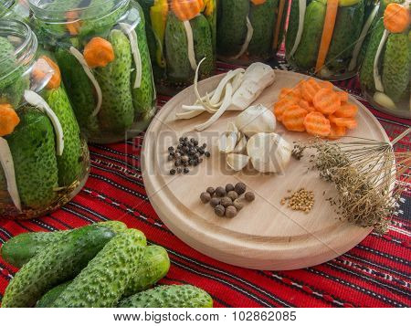 preparing pickled cucumbers assorted with carrots, garlic, pepper, mustard seeds, celery, dill