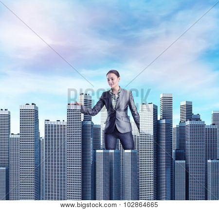 Woman walking among skyscrapers