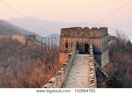 Great Wall closeup in the morning with sunrise and colorful sky in Beijing, China.