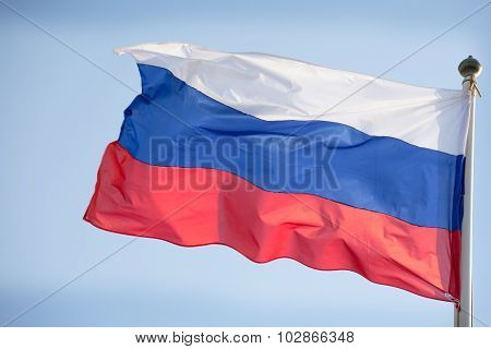 Official Russian Flag On The Blue Sky Background