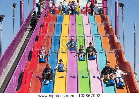 People enjoying a giant slide