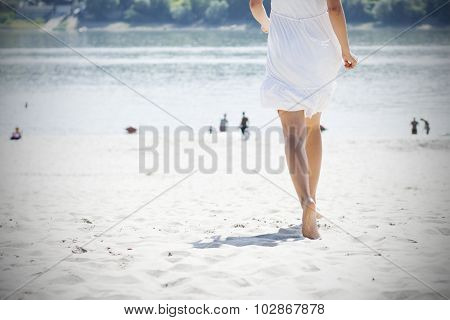 Woman In White Running On Beach